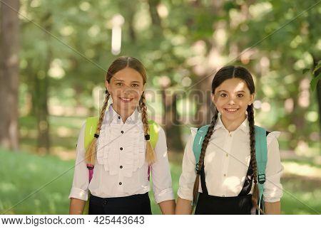Happy Teen Kids Carry Backpack. Back To School. Small School Girls Walking In Spring. Happy Children