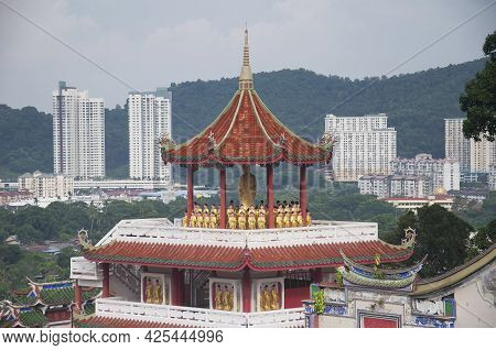 A Gazebo With Many Buddha Statue Within The Kek Lok Si Temple In Penang Malaysia On A Sunny Blue Sky