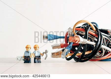 Technicians And A Tangled Bunch Of Network Cables. Illustrative Editorial. Illustrative Editorial. J