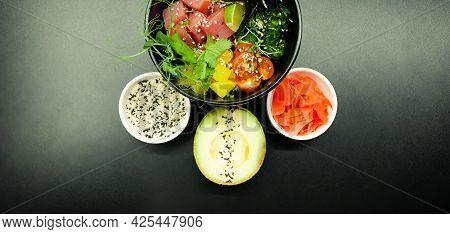 Poke Salad With Tuna In A Bowl. Ingredients Fresh Tuna, Cherry Tomatoes, Marinated Seaweed, Rice, Ta