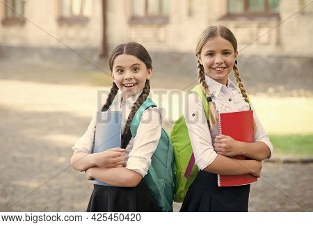 Time To Learn. Happy Kids Hold Study Books Outdoors. Study And Education. Formal Schooling. Private