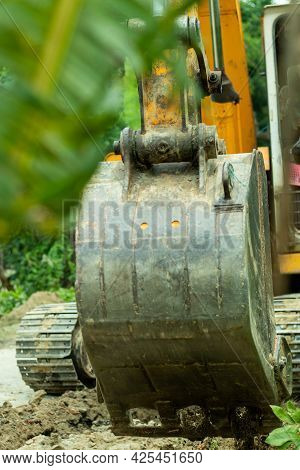 The Excavator Is A Heavy Vehicle And This Is Working On A Road For Excavation