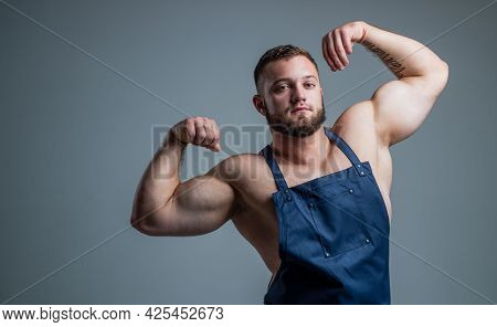 Food Additives For Sportsman. Daily Calorie Diet. Sexy Chef In Apron. Muscular Man Cooking. Healthy