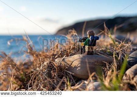 Miniature Landscape Photographer Taking Pictures. Illustrative Editorial. June 30, 2021