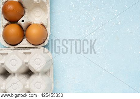 Eggs In Eco Package On Blue Cement Background.zero Waste Cconcept. Package-free Food Shopping. Top V