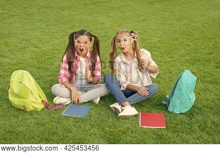 Playing Together. Spend Free Time With Party Glasses. Small Kid Friends Relax On Grass. Back To Scho