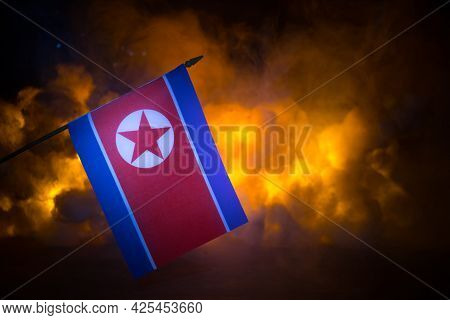 Flag On Burning Dark Background. Concept Of Crisis Of War And Political Conflicts Between Nations.
