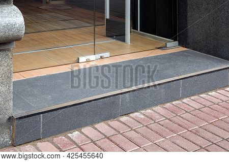 A Threshold With A Doorstep At The Entrance To The Store With A Tempered Glass Door In The Doorway T