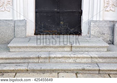 Granite Threshold At The Entrance Door Made Of Black Rust Iron And White Facade Cladding Of Gray Gra