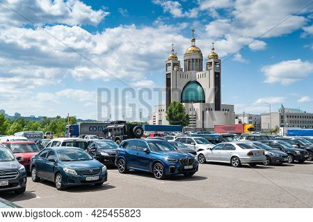 Cars In The Parking Area. Cars At The Parking Lot Of The International Exhibition Arms And Security