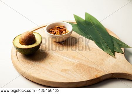 Avocado And Nuts On A Wooden Board. Healthy Food Rich In Protein. Ingredients Full Of Healthy Fat On