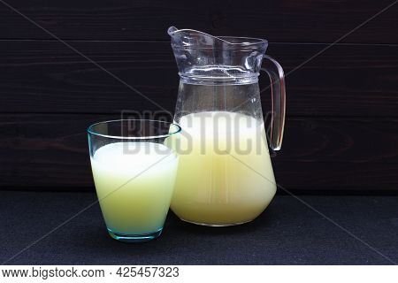 Whey In A Glass And Jug On A Dark Background