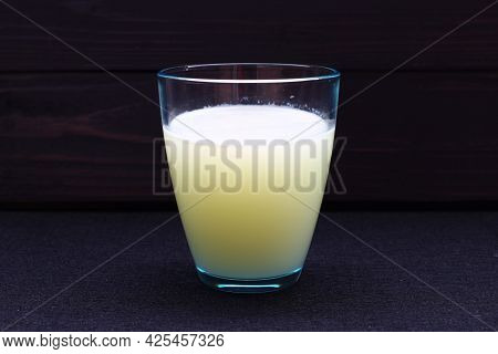 Whey Milk In A Glass On A Dark Background