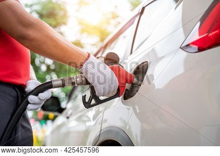 Close-up Hand Of Gas Refueling Worker Wearing Gloves Is Refueling Customers, Pumping Equipment Gas A