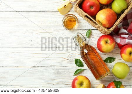 Homemade Apple Vinegar And Ingredients On White Wooden Table