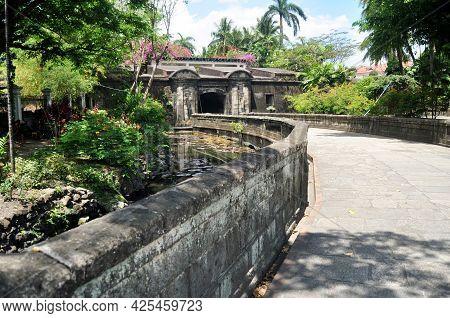 Garden Park And Ancient Antique Vintage Retro Gate Entrance Of Baluarte De San Andres Spanish Coloni