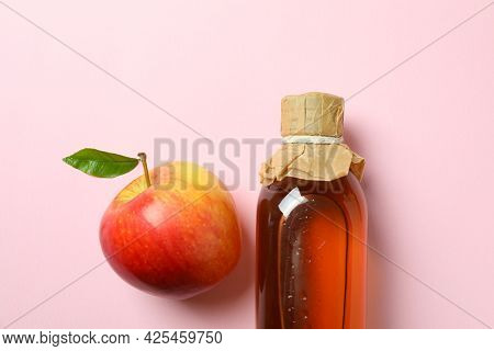 Homemade Apple Vinegar And Ingredient On Pink Background