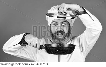 Preparing Food In Kitchen. Cooking Food Concept. High Quality Frying Pan. Bearded Cook Uniform Man H