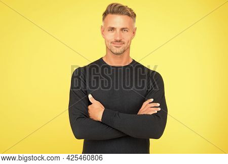 Confident Guy With Groomed Face. Handsome Man Crossed Hands Wear Black. Male Fashion And Beauty. Guy