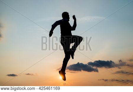 Energetic Man Runner Silhouette Running To Future Against Sunset Sky, Success
