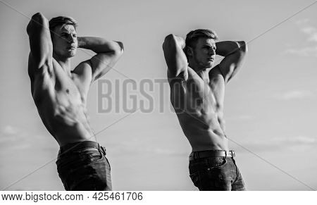 Double Power. Muscular Twins. Men Brothers Muscular Guys Sky Background. Strong Muscular Athlete Bod
