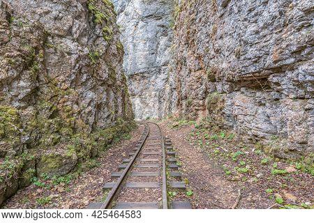 Narrow Gauge Railway In The Deep Narrow Guam Canyon. Western Caucasus. Russia.