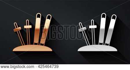 Gold And Silver Ski And Sticks Icon Isolated On Black Background. Extreme Sport. Skiing Equipment. W