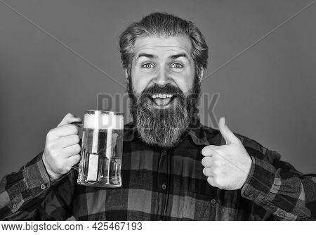 Refresh Your Spirit. Modern Hipster Getting Drunk. Welcome Drink. Brutal Bearded Man Drink Beer. Bee