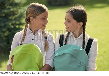 Meet Your Best Friends Today. Happy Girls Hold School Bags. Girls Education. Back To School. Beauty