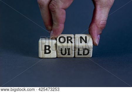 Born Or Build Symbol. Businessman Turns Wooden Cubes And Changes The Word 'born' To 'build'. Beautif