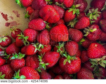 Fresh Organic Strawberry Fruit Red Background In Summer.