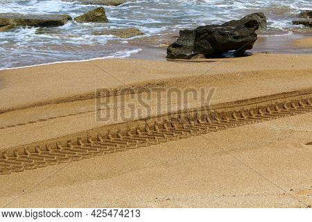 Footprints In The Sand On The Shores Of The Mediterranean Sea In Northern Israel. Hot Summer In Isra