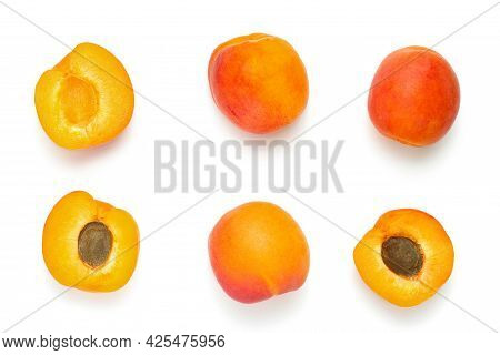 Fresh Delicious Apricots Isolated At The White Background, Apricots And Sliced Apricots In Two Rows