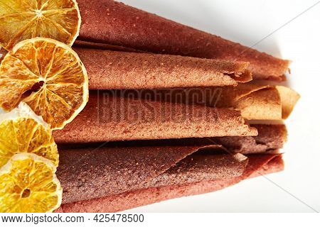 Above View Of Natural Fruit And Berries Lozenge Different Colors And Dried Tasty Orange On White Bac