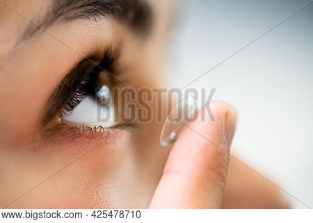 Inserting Contact Lens In Eye. Ophthalmology Eyewear
