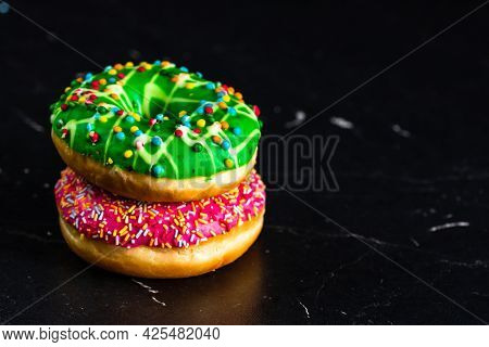 Glazed Donuts With Sprinkles Isolated. Close Up Of Colorful Donuts.