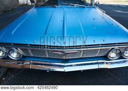 Ramsgate, United Kingdom - June 10, 2021: The Hood Of A 1961 Chevy Bel Air. A Blue 1961 4 Door Chevr