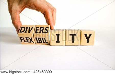 Diversity And Flexibility Symbol. Businessman Turns Wooden Cubes And Changes The Word Flexibility To