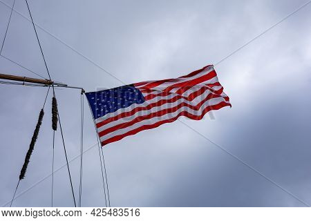11 June 2021, A National Flag Of United States Of America, Fluttering In The Wind, On Mast Of An Ame