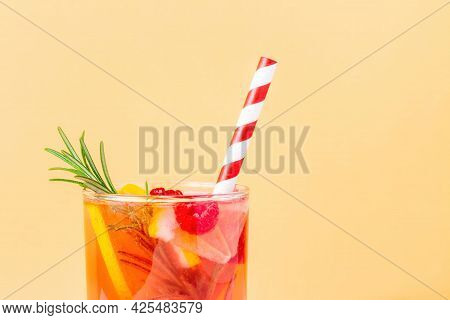 Nonalcoholic Cocktail With Lemon And Raspberry And Rosemary On A Beige Background. Top Of Glass With