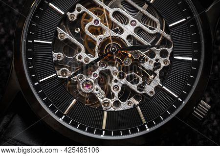 Skeleton Wrist Watch Close-up Photo, It Is A Mechanical Watch Type In Which All Of The Moving Parts