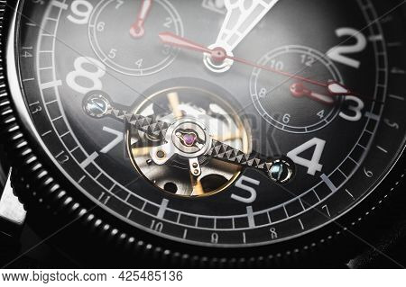 Automatic Mechanical Wrist Watch With Black Clock Face And Red Arrows, Close-up Fragment