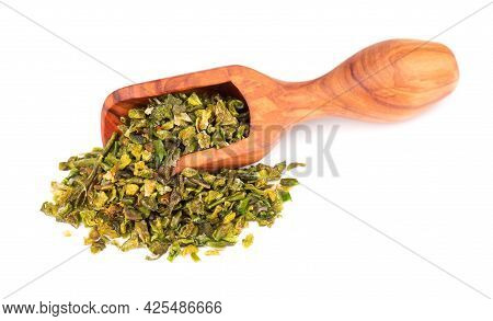 Dried Green Paprika Flakes With Seeds In Olive Scoop, Isolated On White Background. Chopped Jalapeno