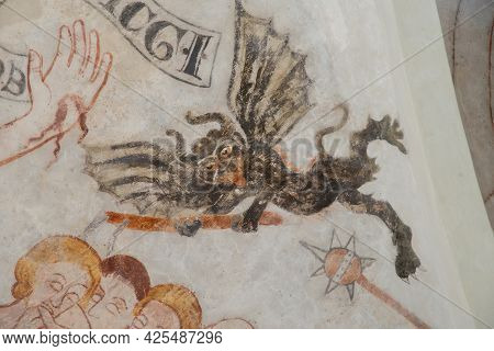 A Black Devil With Bat Wings Hacking At People, An Ancient Gothic Fresco In Skibby Church, Denmark,