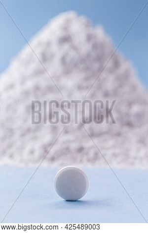White Pill With Zinc Oxide In The Background, Vitamin Concept.