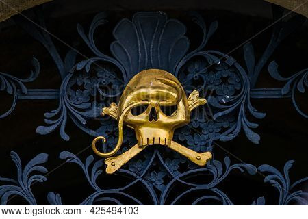 Kuks, Czech Republic - May 15, 2021. Golden Symbol Deats Head Above Entrance To Sporcks Tomb In Cryp
