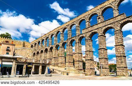 Ancient Roman Aqueduct Of Segovia In Castile And Leon, Spain