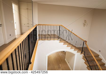 General view of house interior with i spacious hallway and staircase. modern interiors and house decoration concept.