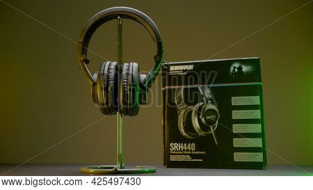 Russia, Moscow - May 5, 2021: New Headphones On Table. Action. New Model Of Headphones With Packagin