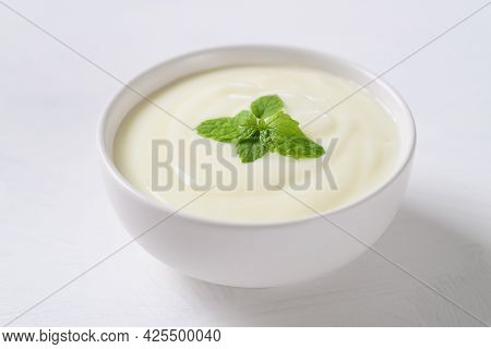 Yogurt In A Bowl With Mint Leaf On White Background, Healthy Food